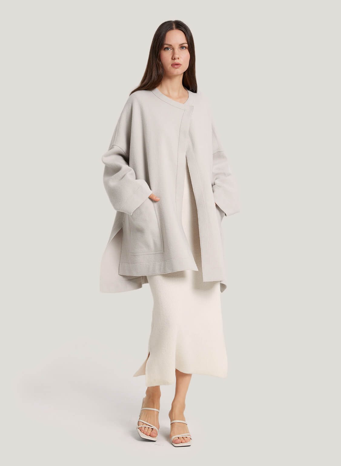 Wrap yourself in the feminine charms of this wool coat. This coat features a clean-lined silhouette